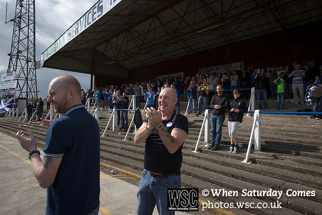 Queen of the South 2 Stranraer 0, 11/08/2015. Scottish Challenge Cup first round, Palmerston Park. Home supporters in the Portland Drive terrace at Palmerston Park, Dumfries, celebrating as Queen of the South (in blue) score their second goal against Stranraer in a Scottish Challenge Cup first round match. The game was the opening match of the season in a competition open to sides below the Scottish Premiership. Queen of the South won the match 2-0, watched by a crowd of 1229 spectators. Photo by Colin McPherson.