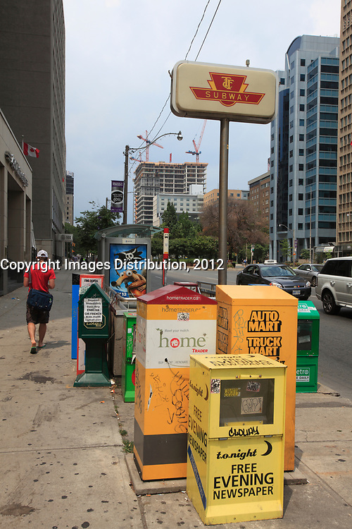 Toronto (ON) CANADA - July 2012 -  Toronto  Transit Commision : newspaper boxes near at subway entrance