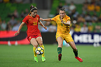 22 November 2017, Melbourne - CAITLIN FOORD (9) of Australia and SONG DUAN (36) of China PR fight for the ball during an international friendly match between the Australian Matildas and China PR at AAMI Stadium in Melbourne, Australia.. Australia won 5-1. Photo Sydney Low