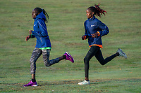Vivian Kiplagat (KEN) (purple shoes) leads Brigid Kosgei (KEN) (white shoes) as they train together within the grounds of the official hotel [location not disclosed] and biosecure bubble ahead of the historic elite-only 2020 Virgin Money London Marathon on Sunday 4 October. The 40th Race will take place on a closed-loop circuit around St James's Park in central London. Wednesday 30th September 2020. Photo: Bob Martin for London Marathon Events<br /> <br /> For further information: media@londonmarathonevents.co.uk
