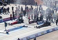 Nov 1, 2020; Las Vegas, Nevada, USA; NHRA top fuel driver Leah Pruett (left) alongside Chris Karamesines during the NHRA Finals at The Strip at Las Vegas Motor Speedway. Mandatory Credit: Mark J. Rebilas-USA TODAY Sports