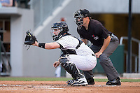 Charlotte Knights catcher Brett Hayes (2) sets a target as home plate umpire Jansen Visconti looks on during the game against the Indianapolis Indians at BB&T BallPark on June 17, 2016 in Charlotte, North Carolina.  The Knights defeated the Indians 4-0.  (Brian Westerholt/Four Seam Images)