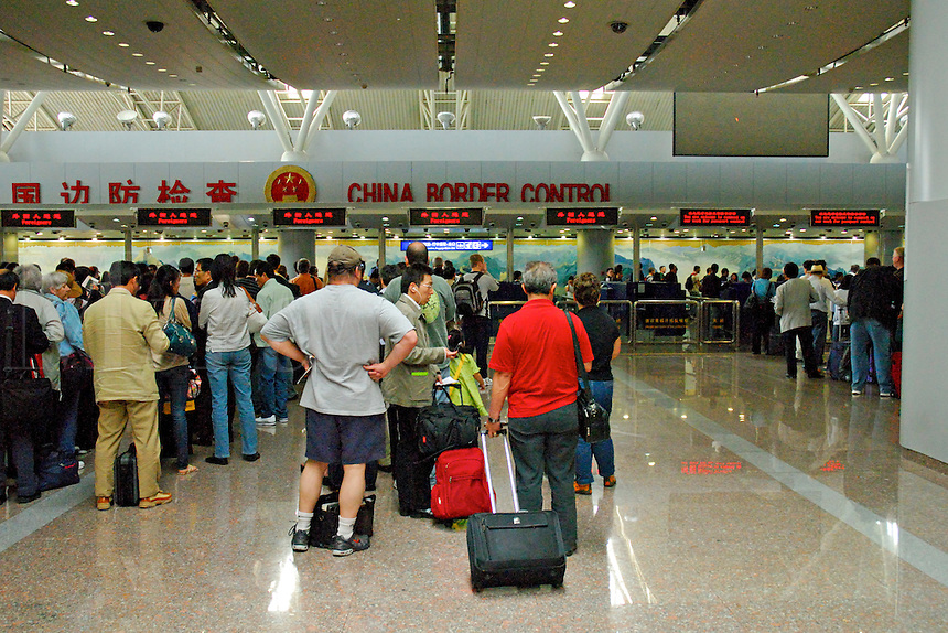 Passengers at Beijing airport form lines at Border Control to enter China.