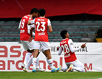 BOGOTA-COLOMBIA, 06-10-2020: Enrique Serge de Independiente Santa Fe, celebra el segundo gol de su equipo, durante partido de la fecha 12 entre Independiente Santa Fe y Alianza Petrolera, por la Liga BetPlay DIMAYOR 2020-I, en el estadio Nemesio Camacho El Campin de la ciudad de Bogota. / Enrique Serge of Independiente Santa Fe, celebrates after scoring the second goal of his team, during a match of the 12th date between Independiente Santa Fe and Alianza Petrolera, for the BetPlay DIMAYOR Leguaje 2020-I at the Nemesio Camacho El Campin Stadium in Bogota city. / Photo: VizzorImage / Luis Ramirez / Staff.