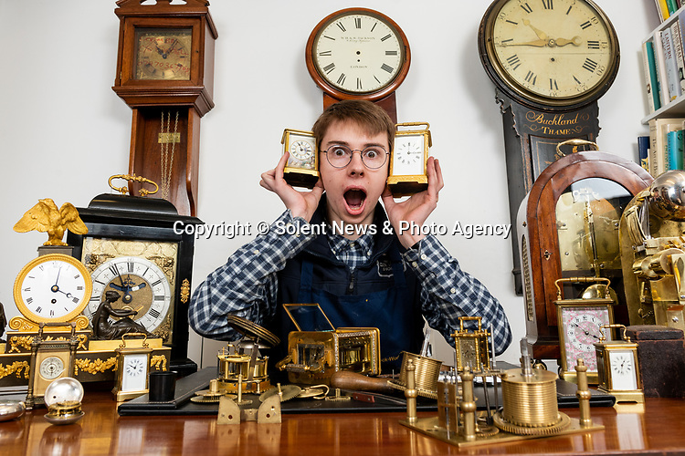 Pictured: Lewis Walduck is the youngest ever clock apprentice at 17 years old at the Clock Work Shop in Kings worthy near Winchester, Hants. <br /> <br /> HE HAS TIME ON HIS HANDS.... Teenager Lewis Walduck is believed to be Britain's youngest clockmaker at the age of just 17 years old.  The youngster's first words were 'tick tock' and he's been obsessed with clocks ever since.<br /> <br /> As well as making a 140 mile round trip three days a week to fulfil his dream of working as an apprentice in a clock shop, he even has 40 in his bedroom - and he says it shakes when they all chime at the same time.  The 17 year old lives with his parents in Bicester, Oxfordshire, and drives 70 miles to the village of Kings Worthy near Winchester, Hants, where he landed his apprenticeship at The Clock Work Shop.  SEE OUR COPY FOR DETAILS.<br /> <br /> © Jordan Pettitt/Solent News & Photo Agency<br /> UK +44 (0) 2380 458800