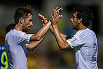 (R) Daniel Parejo of Valencia CF celebrates after scoring with (L) Michel Herrero of Valencia CF during LFP World Challenge 2014 between Valencia CF vs BC Rangers FC on May 28, 2014 at the Mongkok Stadium in Hong Kong, China. Photo by Victor Fraile / Power Sport Images
