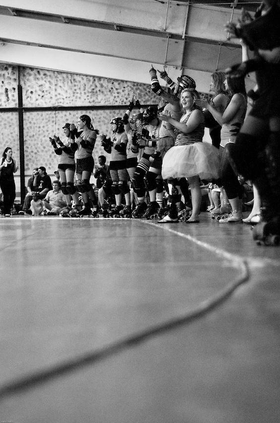 Teammates cheer their friends on at the Richmond Roller Derby