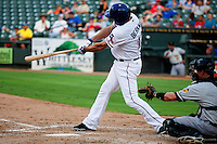 Round Rock Express designated hitter Lance Berkman (12) connects for a third inning home run during the Pacific Coast League baseball game against the Salt Lake Bees on August 10, 2013 at the Dell Diamond in Round Rock, Texas. Round Rock defeated Salt Lake 9-6. (Andrew Woolley/Four Seam Images)