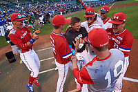 Nolan Gorman (9) of Sandra Day O'Connor High School in Glendale, Arizona is mobbed by teammates including Matthew Liberatore (32), Bobby Witt, Jr. (left), Mason Denaburg (23), and Matt Rudis (19) after winning the home run derby before the Under Armour All-American Game presented by Baseball Factory on July 29, 2017 at Wrigley Field in Chicago, Illinois.  (Mike Janes/Four Seam Images)