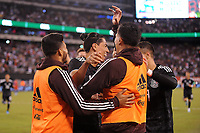 EAST RUTHERFORD, NJ - SEPTEMBER 7: Erick Gutierrez #25 of Mexico celebrates his score with team mates during a game between Mexico and USMNT at MetLife Stadium on September 6, 2019 in East Rutherford, New Jersey.