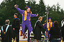 More than 390 students crossed the stage Friday night for the North Kitsap High School graduation. Scott Breitbarth celebrates after receiving his diploma Friday.  (Brad Camp/ Olympic Photo Group)