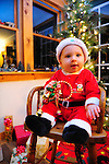 YOUNG CHILD DRESSED AS SANTA AWAITING A CHRISTMAS PORTRAIT