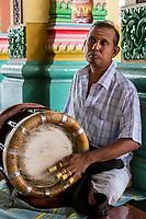 Player Playing a Thavil, a South Indian Drum, Sri Mahamariamman Hindu Temple, Kuala Lumpur, Malaysia.