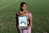 Sukhbeer Kaur (19) holds a portrait of her father, Pippal Singh, who died in 2010 of cancer, aged 40. It is believed that excessive pesticide use in the region over the past 30-40 years has led to the accumulation of dangerous levels of toxins such as uranium, lead and mercury which are contributing to increased health problems including cancers, birth defects and mental disabilities in children. It's a hidden epidemic which is gripping the Punjab region in northeast India which for decades has been the country's 'bread basket'. As local farmers and their families continue to get ill they are paying the price for the country's 'Green Revolution'.
