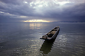 Itaparica Island, Brazil. A dugout canoe floating on a silvery sea; Bahia State.