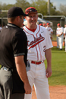 Ball State Cardinals head coach Rich Maloney (2) during the lineup exchange before a game against the Maine Black Bears on March 3, 2015 at North Charlotte Regional Park in Port Charlotte, Florida.  Ball State defeated Maine 8-7.  (Mike Janes/Four Seam Images)