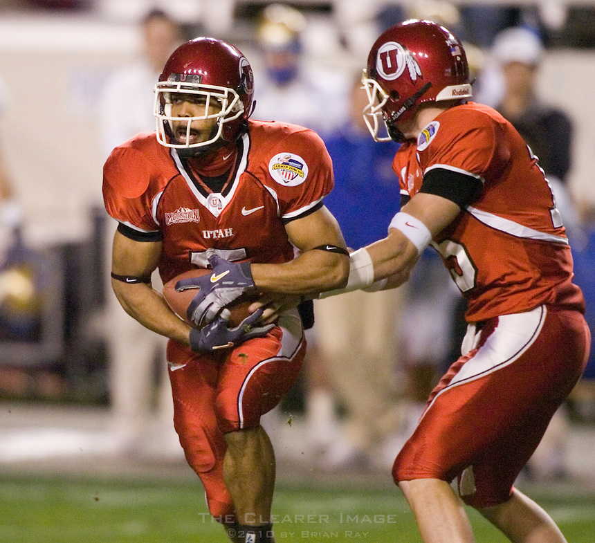 23 December 2006: Utah quarterback Brent Ratliff (#15) hands the ball off to receiver Brent Casteel (#5) during the 2006 Bell Helicopters Armed Forces Bowl between The University of Tulsa and The University of Utah at Amon G. Carter Stadium in Fort Worth, TX.