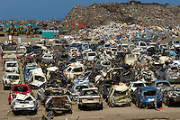 Cars are piled up from the town of Natori that was completely devastated during the March 11th Tsunami in Japan.  The small coastal town was swept away most of it ending up in the rice field a kilometer away.  Now 100 days after the tsunami most of the fields have been cleared of debris and the town has been cleared.  Next to the coast a huge pile of thousands of tonnes of debris, mounting to the entire village, is piled up on the coast, next too hundreds of mangles cars..16 May 2011.photo by Richard Jones  / Sinopix....