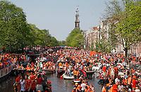 Koningsdag op de grachten in Amsterdam. Copyright: Berlinda (Berbara) van Dam.<br /> Zaandam, The Netherlands.