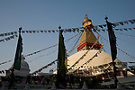 People walk around Boudhanath or Bodnath Stupa in Kathmandu, Nepal.