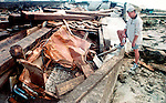 A man from Baton Rogue, La., finds his Chevett that he just bought smashed between two seawalls at the Fontaineblu Terrace in Panama City Beach, Florida after Hurricane Opal struck October 5, 1995.  It and the upside down truck further down the beach were in the parking lot of the Fontaineblu Terrace while he and his friends watch them get swept into the sea during Hurricane Opal.  Opal was the strongest hurricane of the 1995 season and killed 63 people, 13 in the United States.  Hurricane Opal's name was retired the following year.