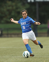 Duke University defender Christina Gibbons (31) passes the ball. Boston College (white) defeated Duke University (blue/white), 4-1, at Newton Campus Field, on October 6, 2013.