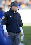 BYU Head Coach Bronco Mendenhall works the sidelines of an NCAA college football game in Reno, Nev., on Saturday, Nov. 30, 2013. (AP Photo/Cathleen Allison)