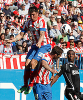 Atletico de Madrid's Cristian Cebolla Rodriguez (l) and Gabi Fernandez (c) and Granada's Allan Romeo Nyom during La Liga match.April 14,2013. (ALTERPHOTOS/Acero)