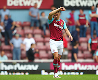 Dejected Aaron Cresswell of West Ham United   during the Barclays Premier League match between West Ham United and Swansea City  played at Boleyn Ground , London on 7th May 2016