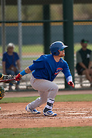 Chicago Cubs center fielder DJ Wilson (24) follows through on his swing during a Minor League Spring Training game against the Oakland Athletics at Sloan Park on March 13, 2018 in Mesa, Arizona. (Zachary Lucy/Four Seam Images)