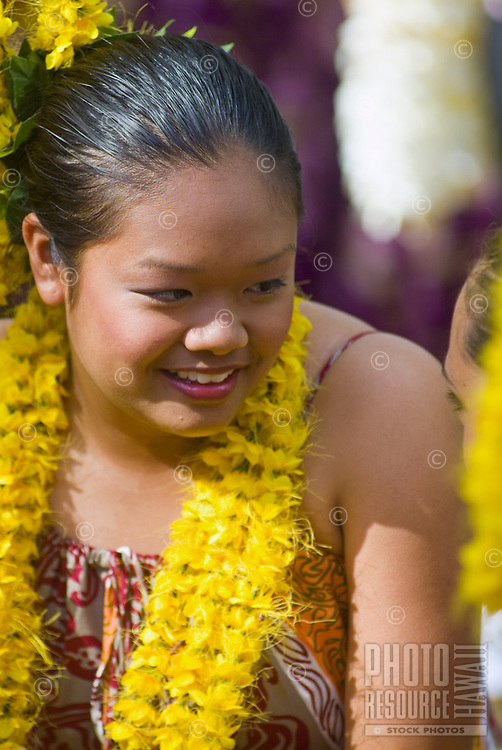 A young hula dancer at Kapiolani park bandstand on May day, also known in Hawaii as lei day