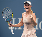 Caroline Wozniacki (DEN) rejoices after defeating Maria Sharapova (RUS) 6-4, 2-6, 6-2at the US Open being played at USTA Billie Jean King National Tennis Center in Flushing, NY on August 31, 2014