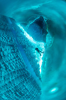 scuba diver and iceberg, Tasiilaq, Greenland, North Atlantic Ocean
