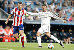 Real Madrid's Cristiano Ronaldo (r) and Atletico de Madrid's Diego Godin during Champions League 2014/2015 Quarter-finals 2nd leg match.April 22,2015. (ALTERPHOTOS/Acero)