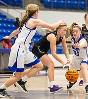 Claudia Bridges (1) of Fayetteville dribbls ball between Taylor Treadwell (33) of Rogers and Ava Maner (23) of Rogers at King Arena, Rogers, AR January 8, 2021 / Special to NWA Democrat-Gazette/ David Beach
