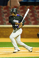 Geoff Rowan #21 of the Northwestern Wildcats follows through on his swing against the Wake Forest Demon Deacons at Gene Hooks Field on February 26, 2011 in Winston-Salem, North Carolina.  Photo by Brian Westerholt / Four Seam Images