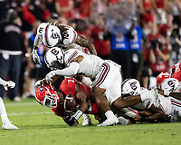 ATHENS, GA - SEPTEMBER 18: Kendall Milton #2 fumbles the ball at the end of a running play during a game between South Carolina Gamecocks and Georgia Bulldogs at Sanford Stadium on September 18, 2021 in Athens, Georgia.