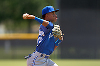 FCL Blue Jays third baseman Angel Del Rosario (43) throws to first base during a game against the FCL Yankees on June 29, 2021 at the Yankees Minor League Complex in Tampa, Florida.  (Mike Janes/Four Seam Images)