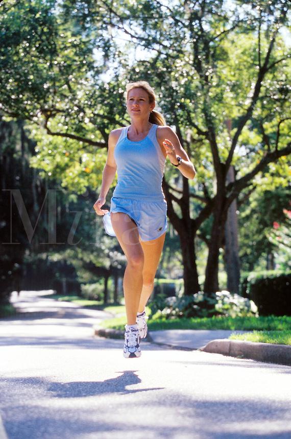 Woman running on the sidewalk.