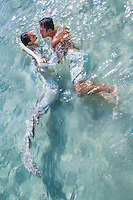 "Recently wedded couple Markee and Set at a ""Trash the Dress"" photo shoot in the ocean near Hau'ula, O'ahu."