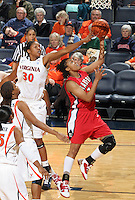 Dec. 6, 2010; Charlottesville, VA, USA; Radford Highlanders guard Breshara Gordon (12) shoots the ball in front of Virginia Cavaliers forward Telia McCall (30) at the John Paul Jones Arena. Virginia won 76-52. Mandatory Credit: Andrew Shurtleff