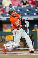 Miami Hurricanes outfielder Carl Chester (9) swings the bat against the UC Santa Barbara Gauchos in Game 5 of the NCAA College World Series on June 20, 2016 at TD Ameritrade Park in Omaha, Nebraska. UC Santa Barbara defeated Miami  5-3. (Andrew Woolley/Four Seam Images)