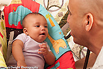 3 month old baby girl in infant seat interacting with father