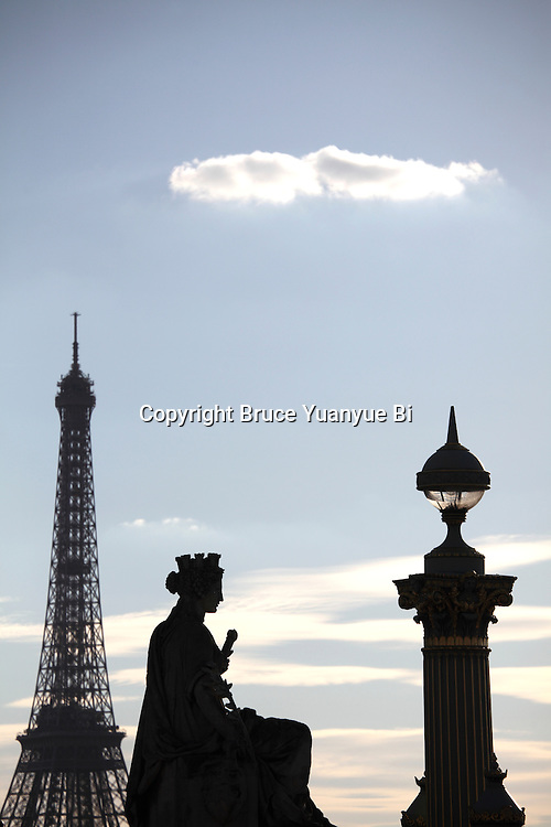 A statue representing French city with a street lamp in Concorde Square Place de la Concorde with Eiffel Tower in the background. Paris. France