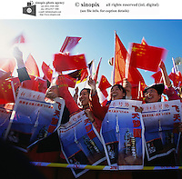 Chinese university students celebrate after China's first astronaut in space returned safely to Earth in Beijing, China. The Shenzhou 5 landed safely as planned after 21 hours in orbit. Beijing's mission control declared the country's landmark debut flight 'a success.'<br />16-OCT-03