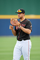 Nashville Sounds first baseman Matt Olson (21) warms up before a game against the New Orleans Baby Cakes on May 1, 2017 at First Tennessee Park in Nashville, Tennessee.  Nashville defeated New Orleans 6-4.  (Mike Janes/Four Seam Images)