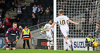 Celebrations as Josh Murphy of MK Dons scores the winning goal during the Sky Bet Championship match between MK Dons and Cardiff City at stadium:mk, Milton Keynes, England on 26 December 2015. Photo by Andy Rowland / PRiME Media Images