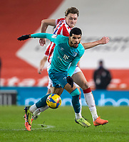 2nd January 2021; Bet365 Stadium, Stoke, Staffordshire, England; English Football League Championship Football, Stoke City versus Bournemouth; Dominic Solanke of Bournemouth under pressure from Harry Souttar of Stoke City