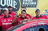 Sept. 25, 2011; Ennis, TX, USA: Crew members for NHRA funny car driver Cruz Pedregon celebrate after winning the Fall Nationals at the Texas Motorplex. Mandatory Credit: Mark J. Rebilas-