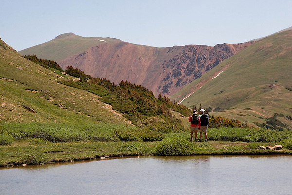 Couple hiking Herman Gulch Trail in James Peak Wilderness Area,, west of Georgetown, Colorado. Private photo tours to Indian Peaks.